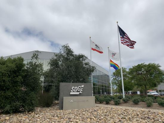 Rainbow flag flying outside Century Park
