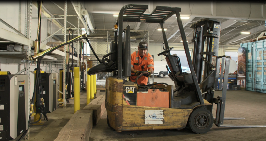 The Port's electric forklift being plugged into the new and efficient charging stations.