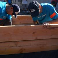 SDG&E employees putting together a raised garden bed